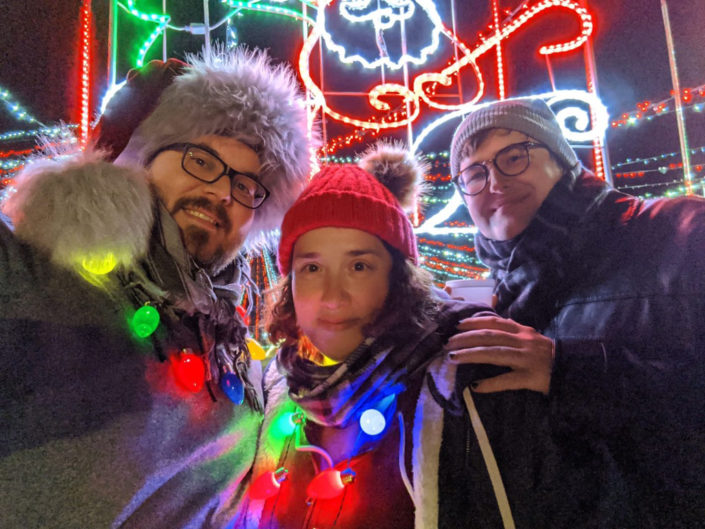 Jonathan and his family at a Christmas light display.